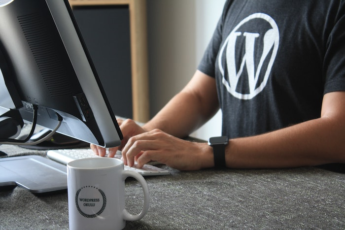 Man wearing black shirt with the WordPress logo.